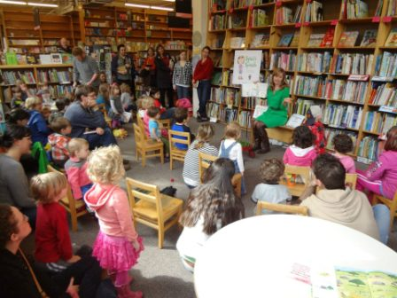 Children surrounding Author Katherine Pryor and learning about ''Slyvia's Spinach'cw'